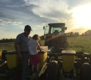 Donn Webb with granddaughter at Webb Farm Services