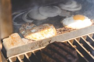 The Mak Griddle is an important part of how to make the best burgers on your pellet grill