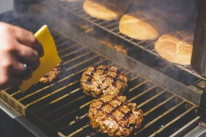 Adding cheese is an important part of how to make the best burgers on your pellet grill.